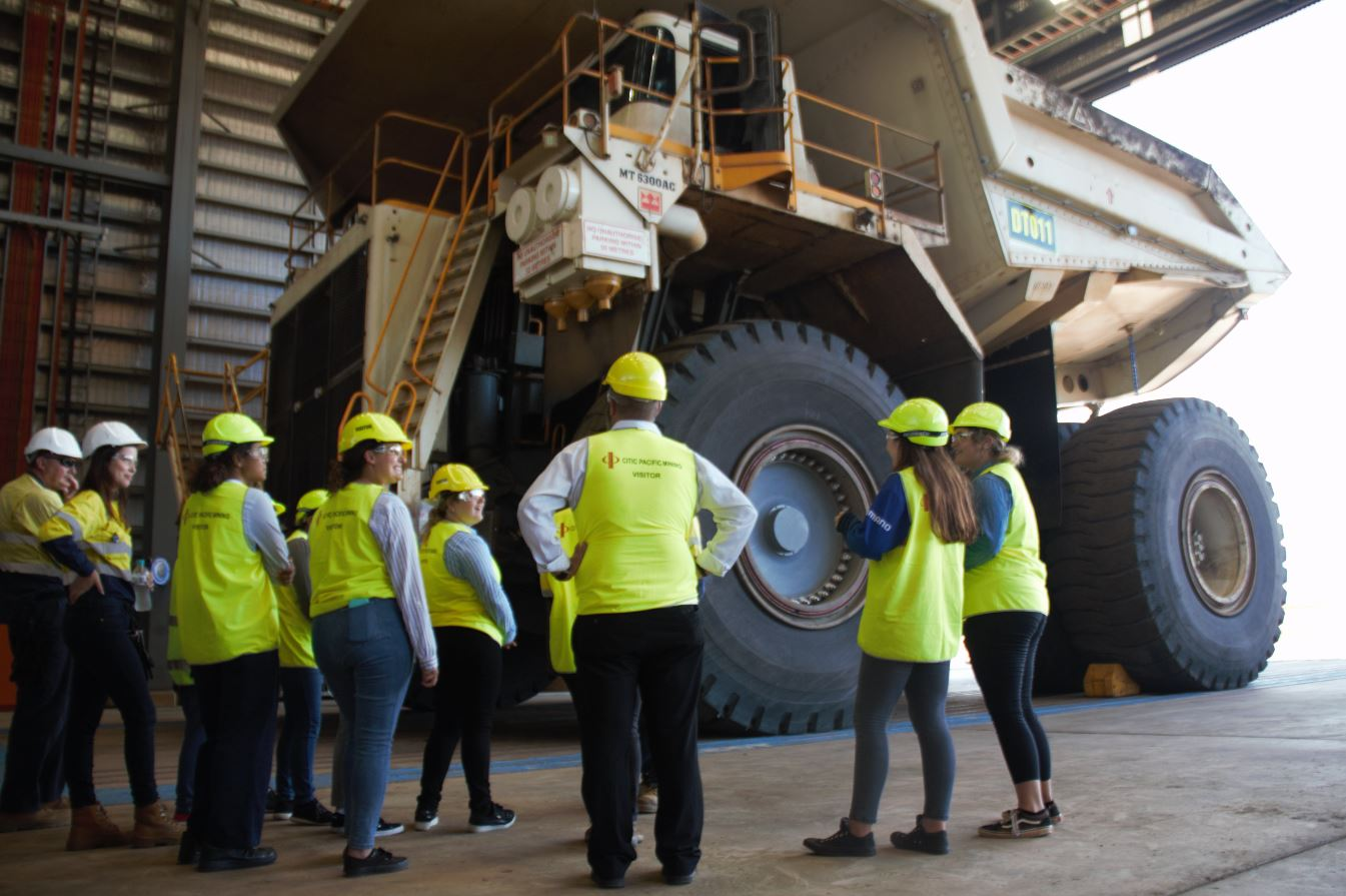Image - students view haul truck on tour of Sino Iron