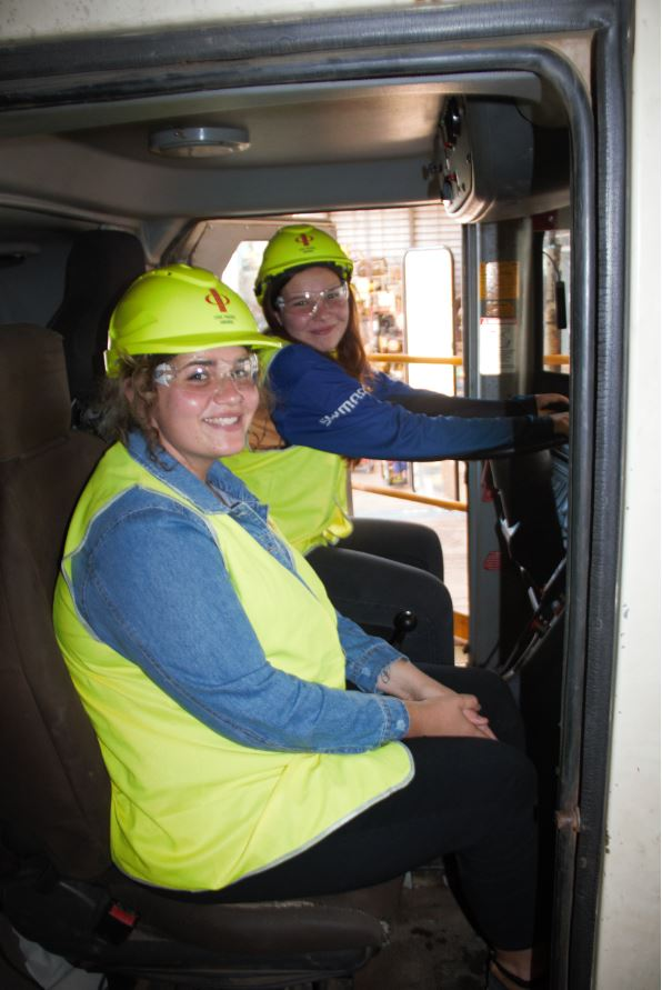Image - students sit in cabin of haul truck on Sino Iron tour
