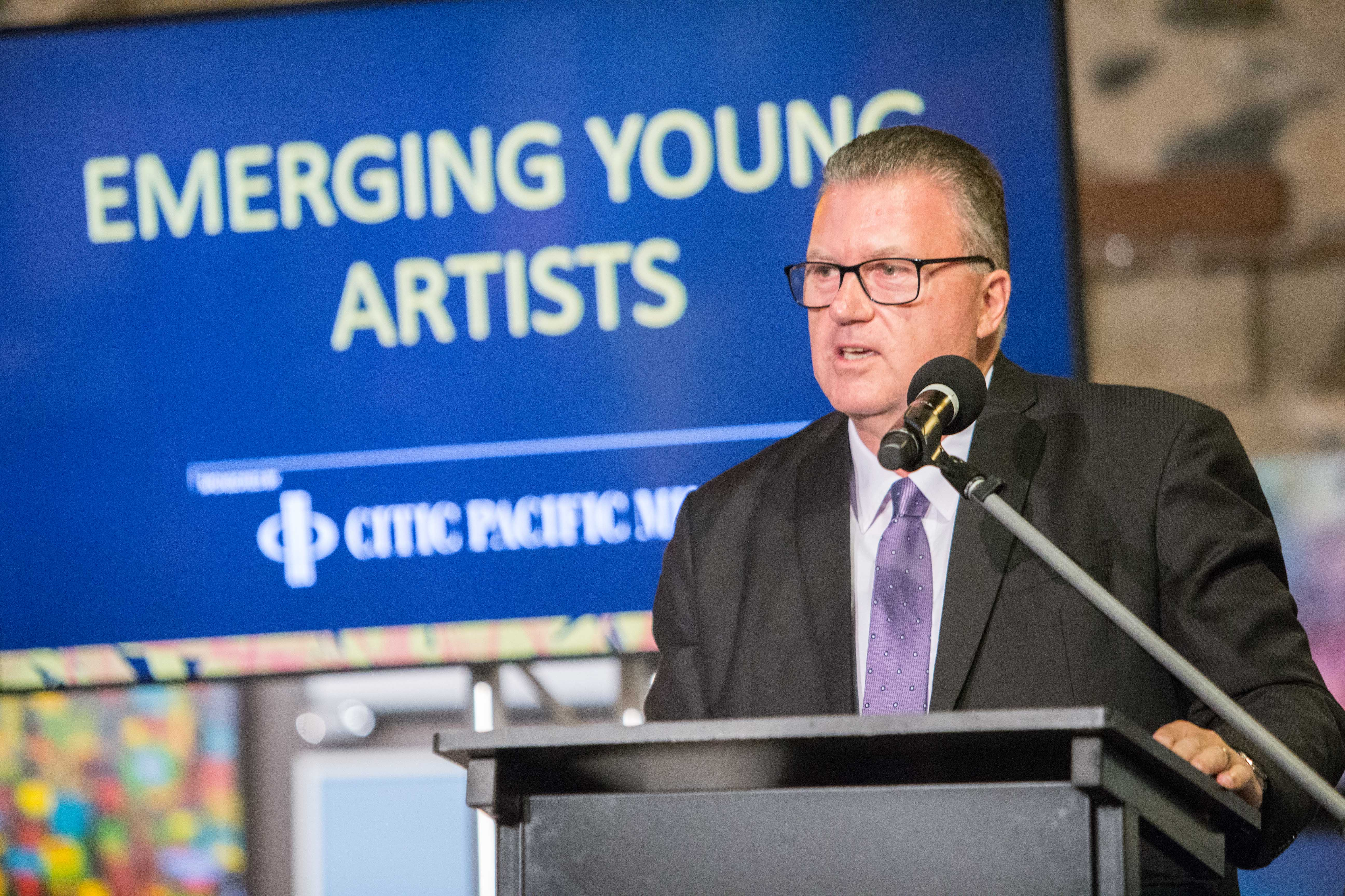 Image of Gary Rayson presenting Emerging Young Artists award at Cossack Art gala 2019